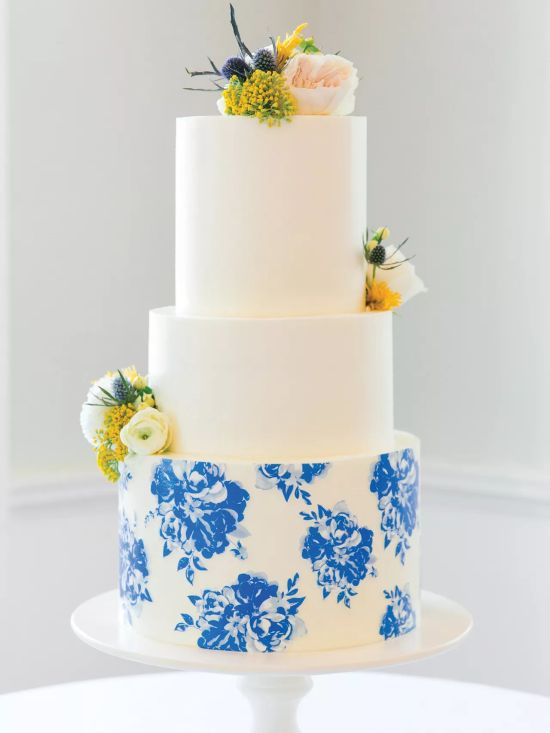 Round White Wedding Cake With Blue Floral Pattern