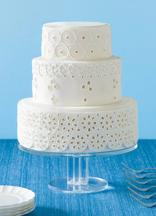 Round White Wedding Cake With Eyelet Icing