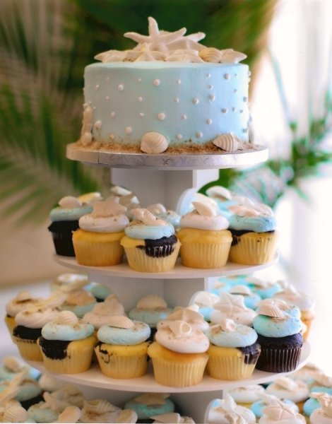 beach wedding cake with cupcakes