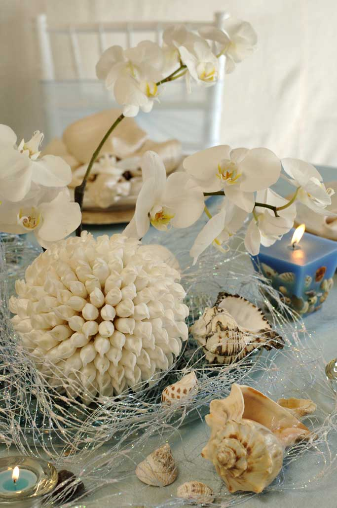 Beach wedding centerpieces with shellscherry marry