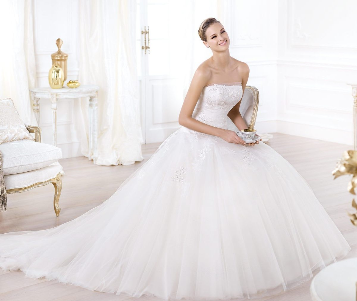 Strapless tulle ball gown wedding dress with chapel for Marry me wedding dresses