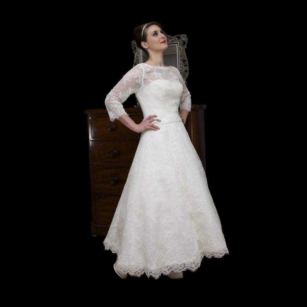 tea length lace ball gown wedding dress with long sleeves