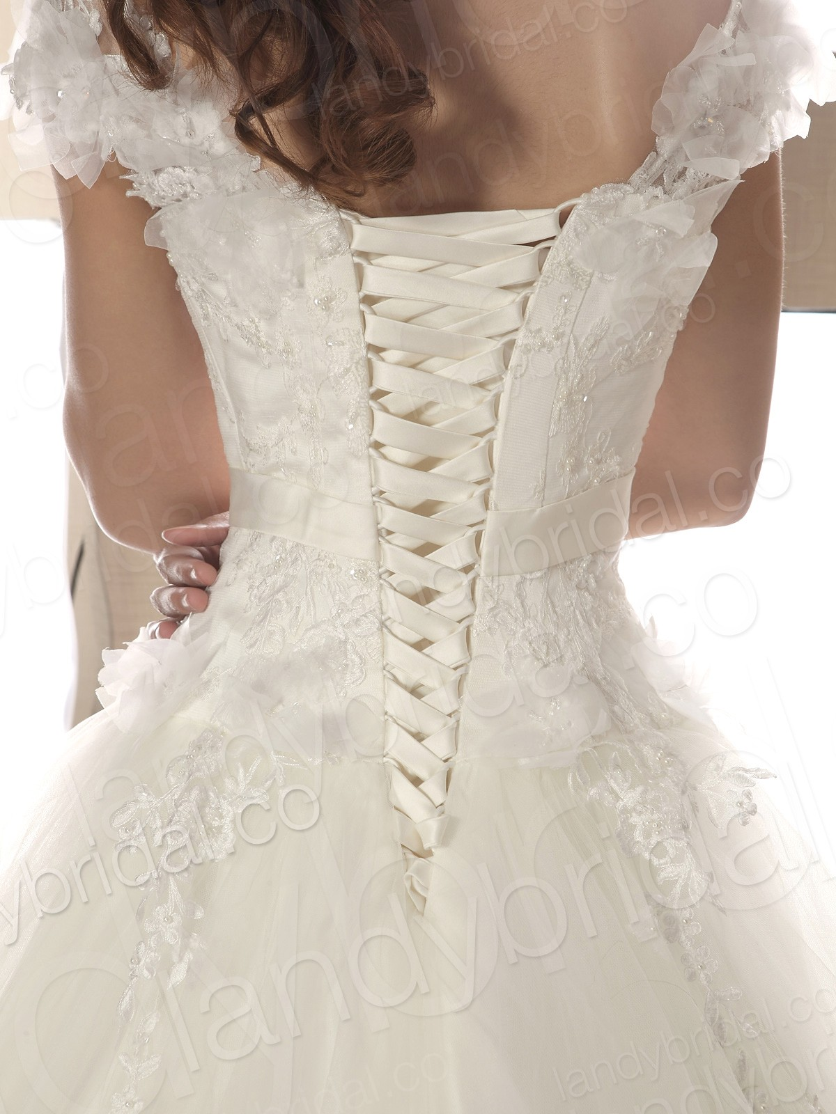 above is a pretty lace up corset white wedding dress with spaghetti