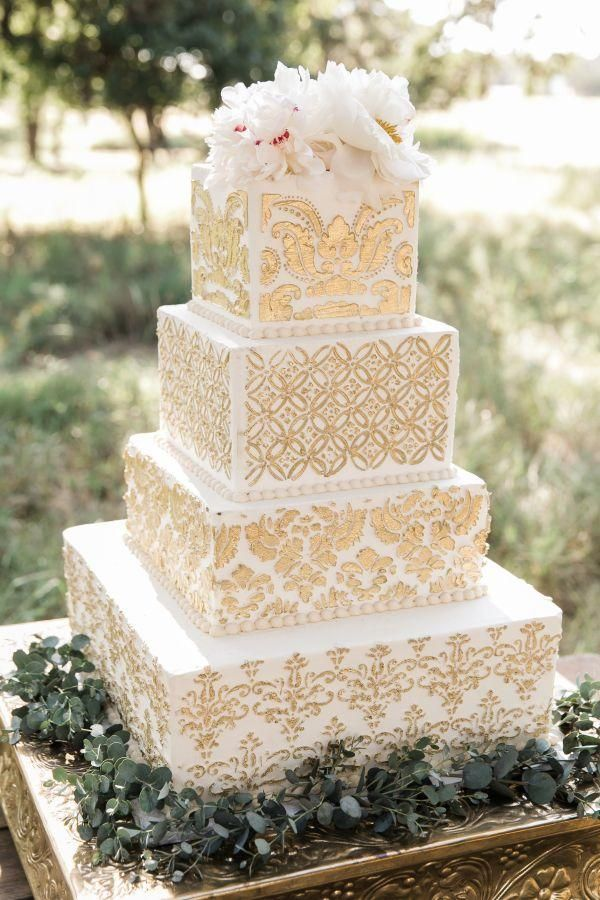 beautiful white wedding cake with unique motif