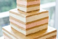 Naked Square Wedding Cake With A Simple Gold Calligraphy Topper For A Modern Wedding