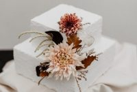 Textural White Wedding Cake With Blush Blooms And Dried Leaves