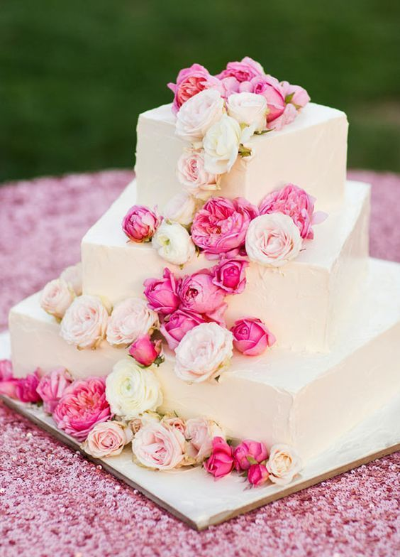 White Square Wedding Cake With Pink And Blush Cascading Blooms