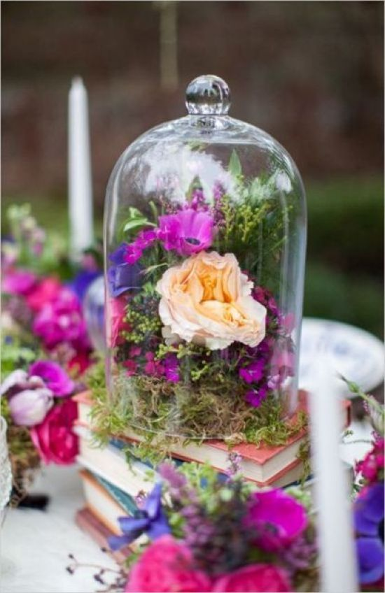 Gorgeous Idea Of Wedding Décor With A Stack Of Books With A Cloche Filled With Moss And Bright Blooms