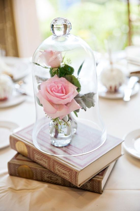 Romantic And Beautiful A Couple Of Books Plus Pink Roses In Vases In A Cloche
