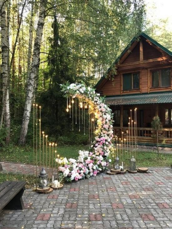 A Moon Wedding Ceremony Altar With Bulbs Lights Around And Lush Pink And White Blooms All Over