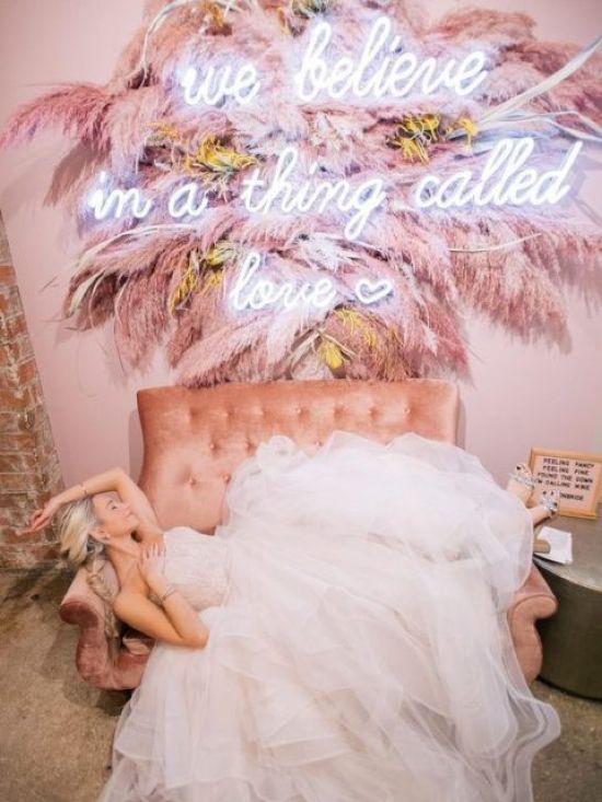 A Wedding Lounge With A Pink Sofa And A Gorgeous Decoration With Pink Pampas Grass And A Neon Sign