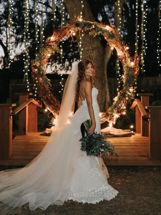 Around Wedding Arch Decorated With Dried Greenery And Herbs Twigs And Lights For A Chic Look With A Rustic Feel