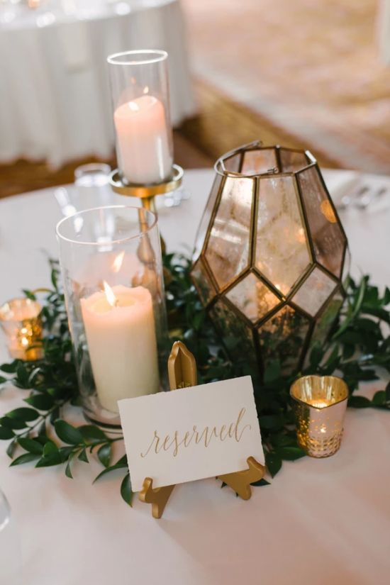 Wedding Reception Table Decoration Ideas With Different Levels Of Candles In Jars And Lanterns