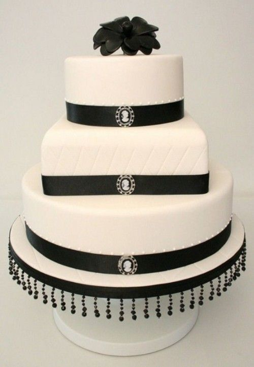 Wedding Cake In White With Black Ribbons And Brooches Plus Beads