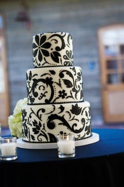White Wedding Cake With Elegant And Chic Black Floral Patterns