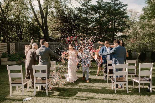 Small Backyard Wedding Reception With White Chairs